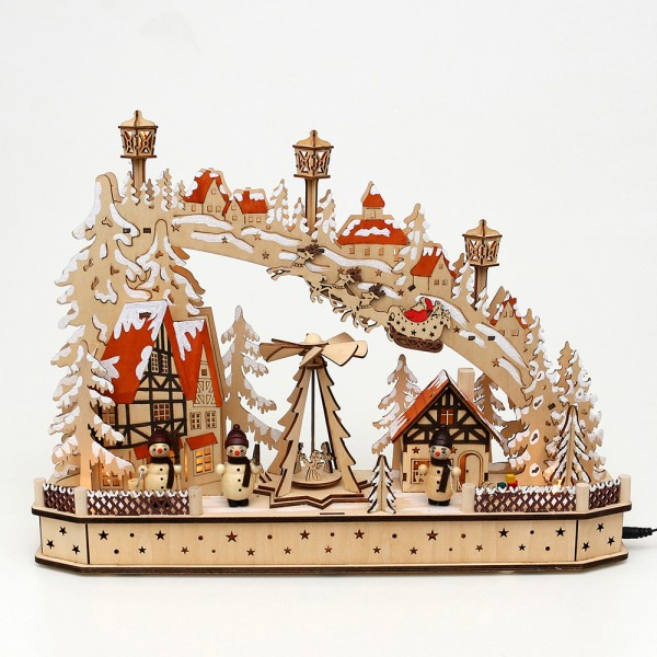 Holz Schwibbogen Weihnachtsabend mit drehender Pyramide & Schneemannfiguren (Rückseite verziert) (Laserholz) 45 x 11 x 33 cm Batteriebetrieb AA, inkl. Adapter 4,5 V, LED, Bewegung, Sound