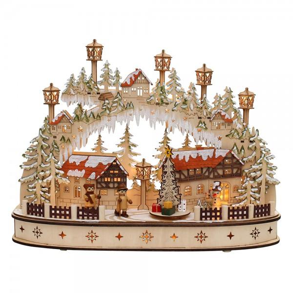 Holz Schwibbogen Stadt verschneit mit bewegtem Weihnachtsbaum, SM & Wanderfiguren (Rückseite verziert) (Laserholz) 45 x 12 x 35 cm Batteriebetrieb AA, inkl. Adapter 4,5 V, LED, Bewegung