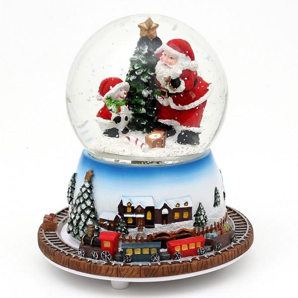 Polyresin Schneekugel Santa mit bewegter Eisenbahn 13,5 x 13,5 x 16 cm Ø 10 cm Bewegung, Spielwerk We wish you a merry Christmas