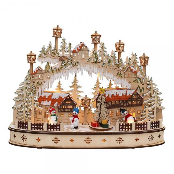 Holz Schwibbogen Stadt verschneit mit bewegtem Weihnachtsbaum & bunten Schneemannfiguren (Laserholz) 45 x 12 x 35 cm Batteriebetrieb AA, inkl. Adapter 4,5 V, LED, Bewegung