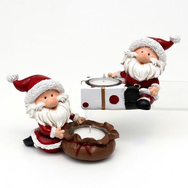 Polyresin Weihnachtsmann Figuren mit Geschenk und Geschenkesack als Teelichthalter 2-fach sort. 14 x 5,5 x 9 cm im Set