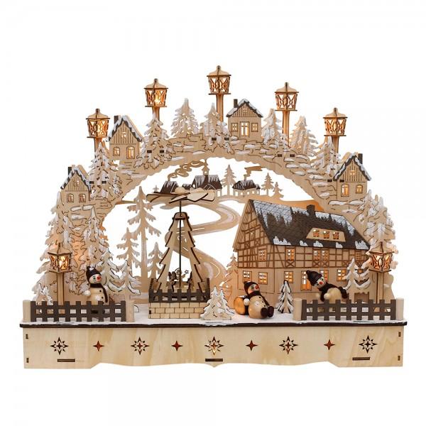 Holz Schwibbogen Dorfhaus verschneit mit bewegter Weihnachtspyramide & Schneemannfiguren (Laserholz) 45 x 12 x 35 cm Batteriebetrieb AA, inkl. Adapter 4,5 V, LED, Bewegung
